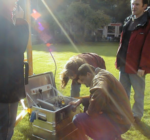 Students setting up a surface - atmosphere exchange measurement system on the lawn at the university in preparation for urban measurements