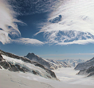 Unusual cirrus clouds viewed from the Jungfraujoch. Airflow over the mountains is thought to have casued these unusual cloud formations